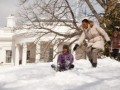 Michelle_Obama_and_her_daughters_in_the_snow-300x199