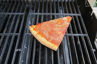Warming pizza in a pan